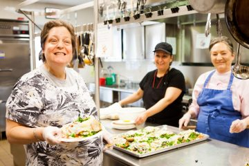 Clients of the Wellspring Clubhouse work in the cafe and run the day-to-day administration as a part vocational rehabilitation programming. (Image courtesy of the Penn Foundation and Wellspring Clubhouse)