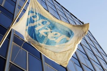 The Pfizer flag flies in front of world headquarters in New York. (AP Photo/Mark Lennihan