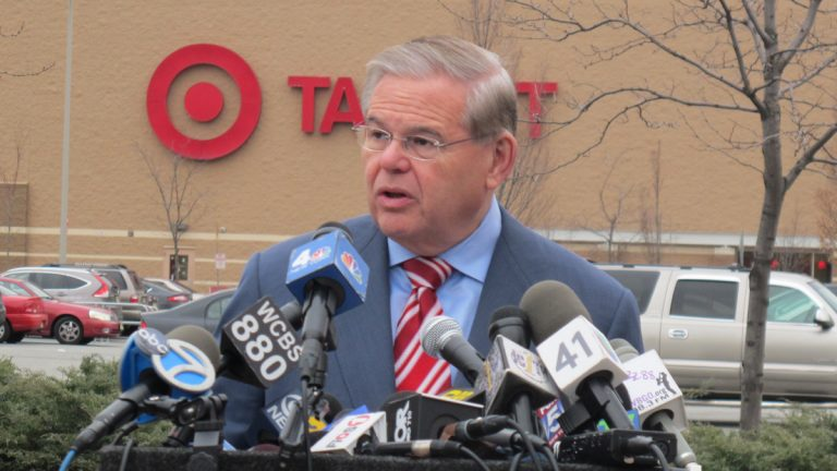 U.S. Senator Bob Menendez of New Jersey discusses his concerns in front of a Target store on 14th Street in Jersey City (Phil Gregory/for NewsWorks)