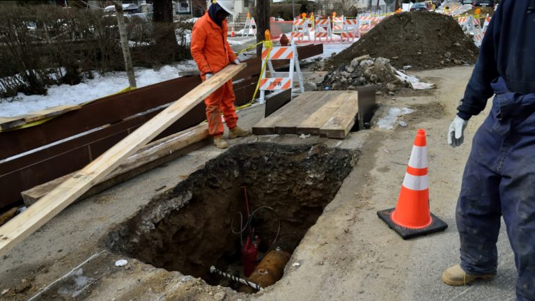 A PGW crew works at the intersection of E Durham St and Boyer St. in Philadelphia. (Bas Slabbers/for NewsWorks)