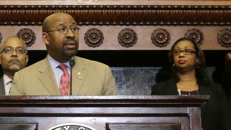 Desiree Peterkin Bell (right) stands with Philadelphia Mayor Michael Nutter during a news conference Tuesday