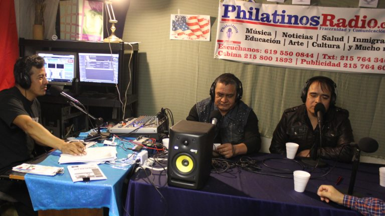 On a recent Tuesday evening, Javier Garcia Hernandez and his guests broadcast from the small studio of Philatinos Radio in South Philadelphia. (NewsWorks photo/ Emma Jacobs)
