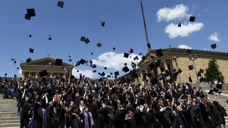 Over 300 graduating students from 19 Philadelphia-area colleges and universities are shown throwing their mortarboards in the air on the steps of the Philadelphia Museum of Art in a 2012 ceremony. (Alex Brandon/AP Photo, file)
