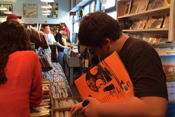 Having secured the latest Pixies release, the author's son, Jack, combs through the vinyl selections at Main Street Music. (Amy Z. Quinn/for NewsWorks)