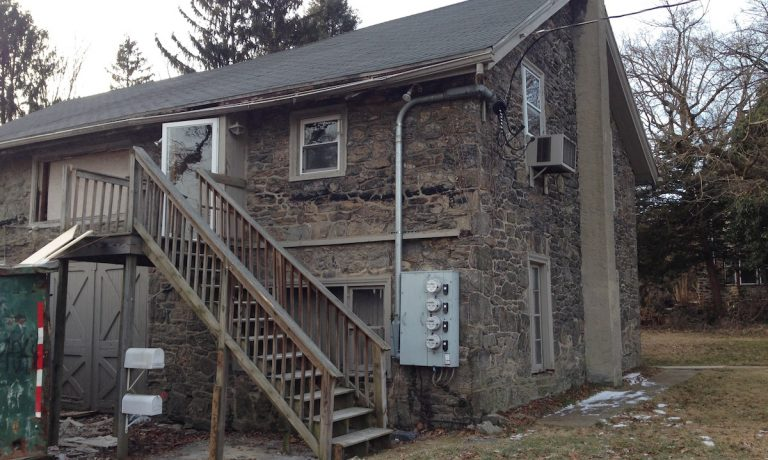 The carriage building behind 6024 Wayne Ave. will be converted into classroom space. (Daniel Pasquarello/for NewsWorks)