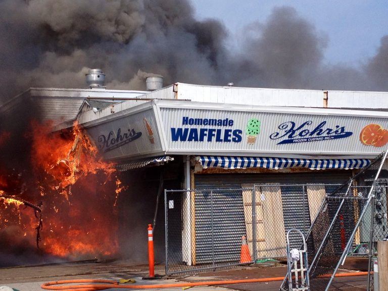 Flames shoot out of Kohr's during the early stages of the last week's fire. (Photo: Justin Auciello/Jersey Shore Hurricane News)
