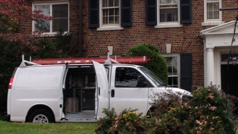 The PSPCA van outside the famed Grace Kelly house in East Falls. (Brian Hickey/WHYY)
