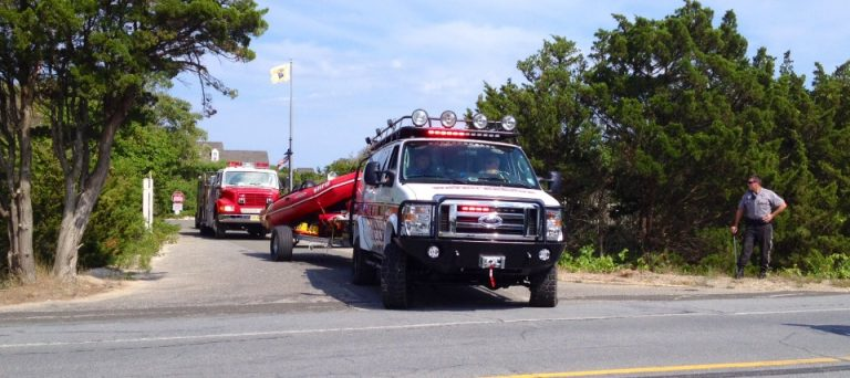 A Seaside Heights water rescue truck departs the Governor's Mansion in Island Beach State Park Thursday afternoon. Units were on hand at the location to establish a landing zone for a medevac, which was later cancelled. A woman pulled from the ocean was then transported by an ambulance to a local hospital. (Photo: Justin Auciello/for NewsWorks)