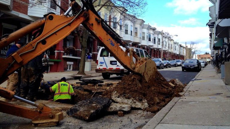 PWD has been working to repair a water main break on the unit block of West Sharpnack Street. (Jana Shea/for NewsWorks)