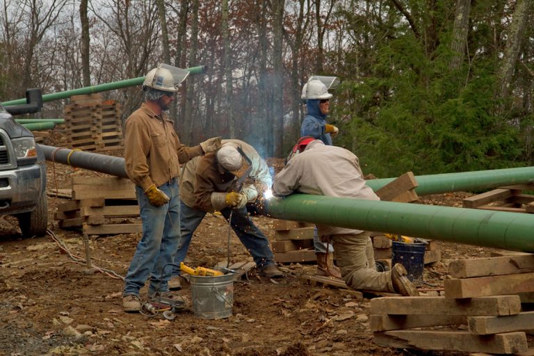 Crews are shown welding a pipeline connecting to a natural gas well in northern Pennsylvania. The Mariner East 2 plan would build two natural gas pipelines across southern Pennsylvania. (Lindsay Lazarski/WHYY
