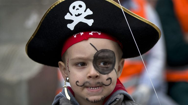 A boy wears a pirate's costume after a Halloween party. (AP Photo/Vadim Ghirda, file)
