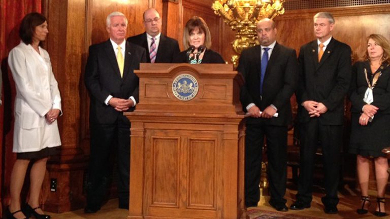 Vicki Pizzullo of Bucks County speaks after a bill in her daughter Hannah's named was signed into law Wednesday by Pa. Gov. Tom Corbett. The law mandates testing newborns for six more metabolic disorders. (Mary Wilson/WHYY)