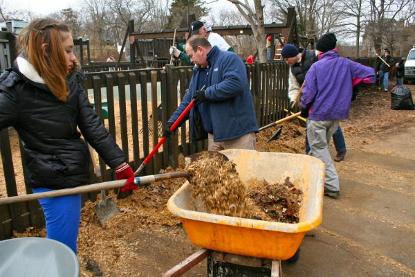 Volunteers clean up Houston playground in Mt. Airy on MLK Day 2013. (Lane Blackmer/for NewsWorks, file)
