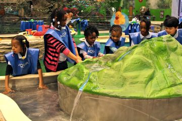 Children enjoy the water play area at Philadelphia's Please Touch Museum. (Emma Lee/WHYY)