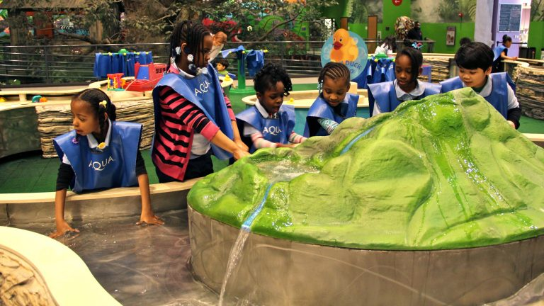 Children playing in the water play area at Philadelphia's Please Touch Museum