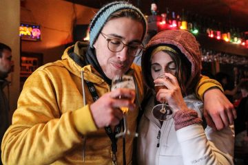 Andrew Wummer and his girlfriend Christina Forysthe enjoy their Russian River Pliny the Younger Triple IPAs at Monk's Cafe Monday. (Kimberly Paynter/WHYY)
