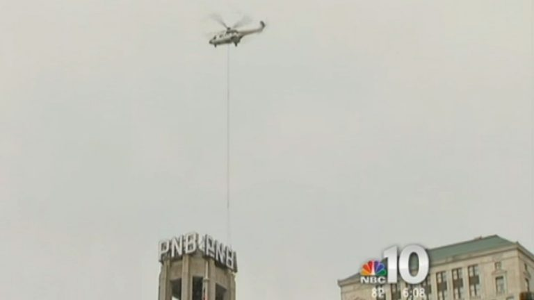 Safety concerns prevented crews from removing all 12 letters from the former Philadelphia National Bank building on South Broad Street on Sunday. (Image courtesy of NBC 10 video)