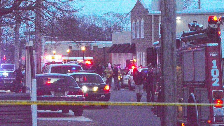 Investigators work at the scene of the Wilmington Police shooting Thursday.(John Jankowski/for NewsWorkrs)