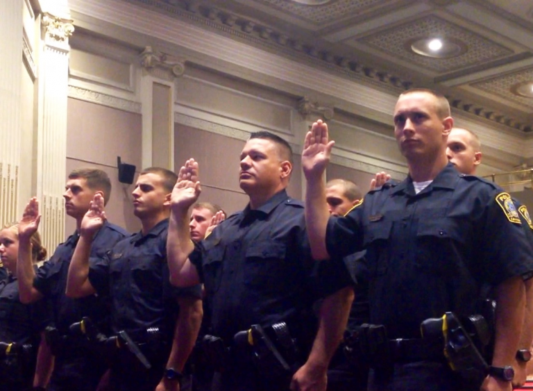 The Lexington Police Department swearing in new officers in July 2014. (Josh James/WUKY)