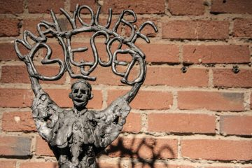'May you be blessed', a patinated resin sculpture by Erica Volpe. (Kimberly Paynter/WHYY)