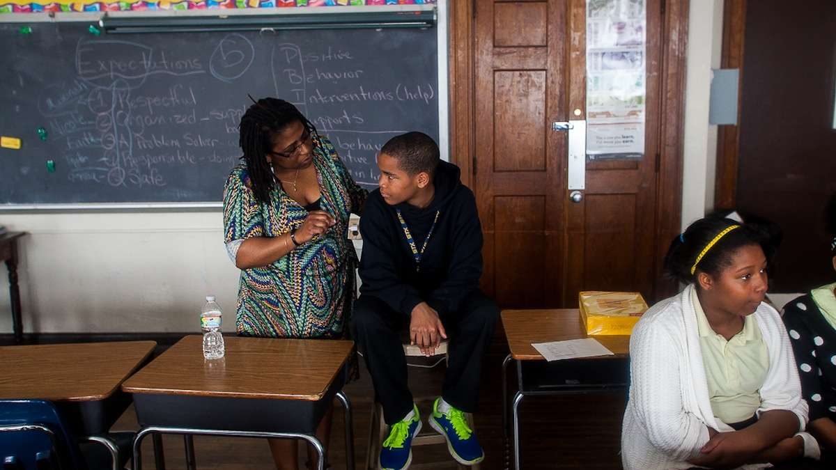 Roosevelt's Cynthia Byron talks with sixth grader Zymeer Mcleod who helped put on the the Positive Behavior Intervention Supports (PBIS) presentation earlier in the day. (Brad Larrison/for NewsWorks)