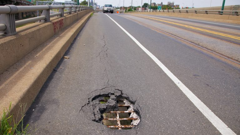 A pot hole is shown in an East Girard Avenue overpass in Philadelphia. (Nathaniel Hamilton/for NewsWorks, file)