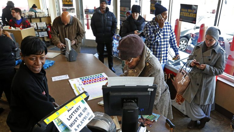 A line forms over the lunch hour at a minimart in Pittsburgh to purchase a chance at the record $1.5 billion Powerball jackpot, Wednesday, Jan. 13, 2016. (AP Photo/Gene J. Puskar)