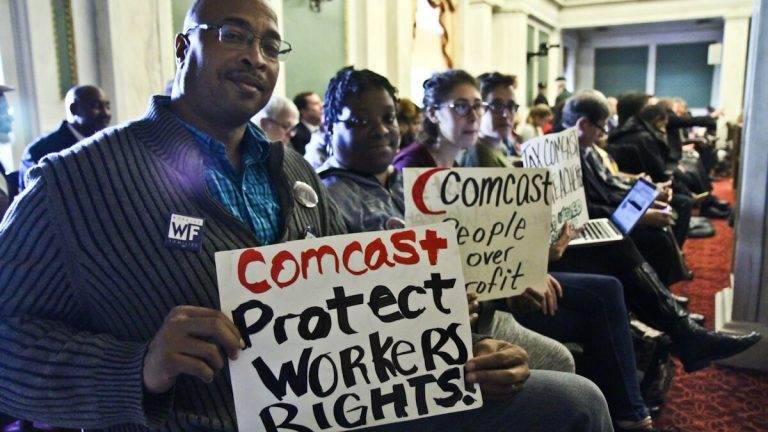 (From left) Will Dickens, Keidra Goldsmith, Len Glickman, and Hannah Sassaman with Working Families are present during a meeting at which city council votes on whether the city of Philadelphia will make a deal with Comcast. (Kimberly Paynter/WHYY)