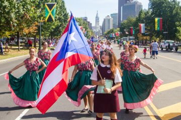 Students from Little Flower Catholic High School for Girls in Northeast Philadelphia performed at the Puerto Rican Day Parade Sunday. (Brad Larrison/for NewsWorks)