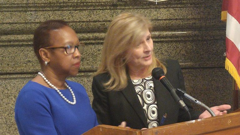 Loretta Sweet Jemmott (left) and Sharon Easterling discuss the final report on Philadelphia's plan for citywide pre-K. (Tom MacDonald/WHYY)