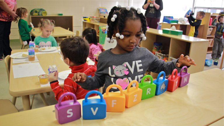 Makayla Grant gets busy on her first day of preschool at SPIN-Parkwood on Jan. 4