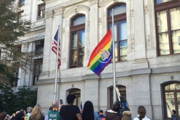 The city's pride flag is raised outside of Philadelphia City Hall in October 2015. (Eric Walter/WHYY