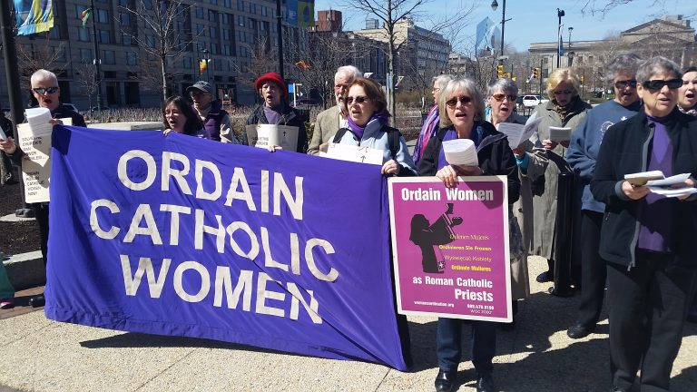 Women who want to be Catholic priests  protest outside Holy Thursday Mass at Philadelphia's Cathedral Basilica of Sts. Peter and Paul.  (Tom MacDonald/WHYY)