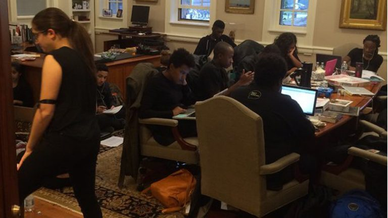 Princeton University students protest inside the school president's office, demanding changes for the social and academic experience of black students.(Photo/WPRB)