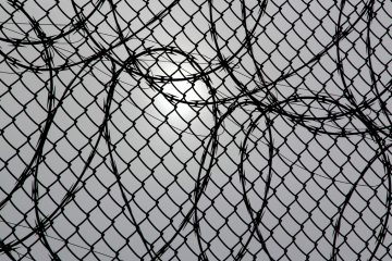 Fencing at a correctional facility in Philadelphia. (Emma Lee/WHYY, file)