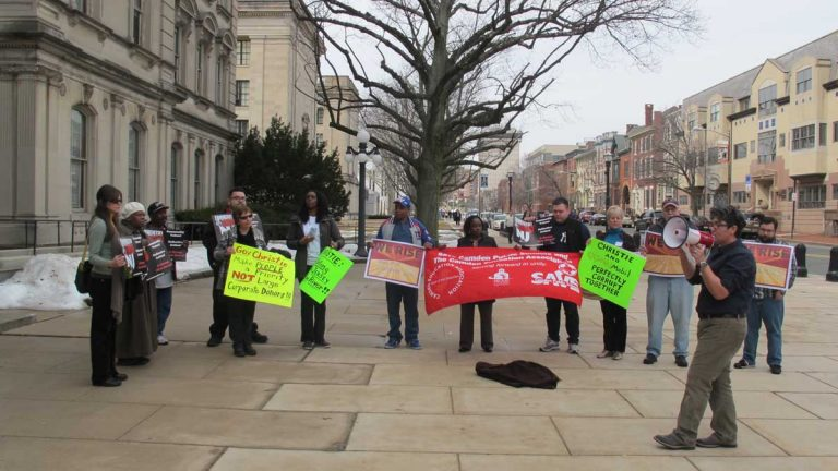 Protesters rally outside the New Jersey State House in Trenotn to call attention to budgetary priorities they say are out of kilter. (Phil Gregory/WHYY)
