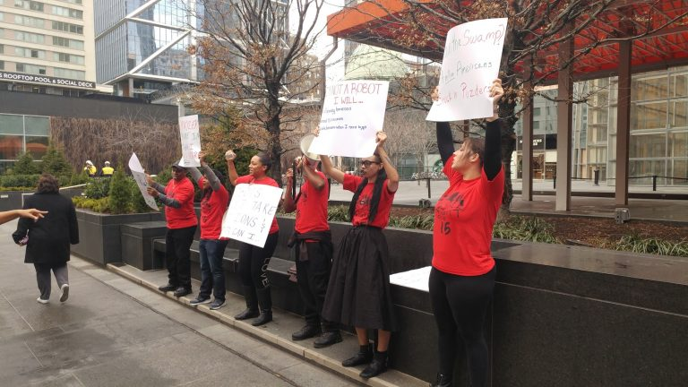 Protesters call for an increase in Pennsylvania's  minimum wage of $7.25 an hour Thursday. (Tom MacDonald/WHYY)