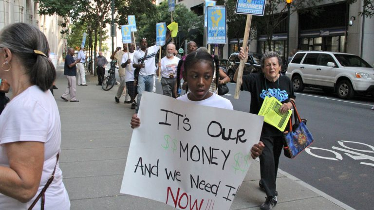 Amani Bassett, 9, marches with Action United outside the offices of the Philadelphia School Partnership on Chestnut Avenue. (Emma Lee/for NewsWorks)