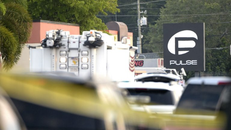 Police cars and emergency vehicles surround the Pulse Orlando nightclub