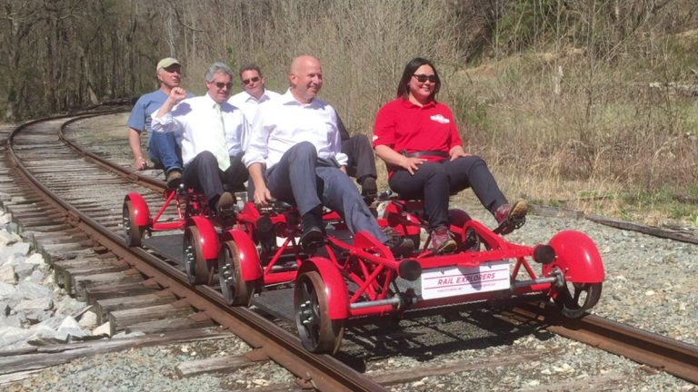 Delaware Governor Jack Markell takes on of the first rides on the Rail Explorers bikes through scenic Yorklyn. (Zoë Read/WHYY)