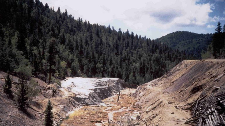 Mine tailings and water laden with heavy metals spilled out below the Rawley12 mine tunnel on the Rio Grand National Forest
