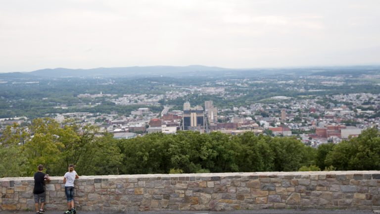 Two teenagers take in the view of Reading, Pa. from Mount Penn near the Pagoda.  (Lindsay Lazarski/WHYY)