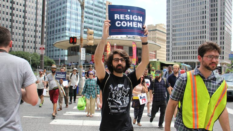 Members of Reclaim Philadelphia march through Center City to demand that the DNC reveal its sources of funding. (Emma Lee/WHYY)