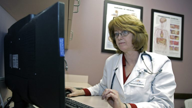 Are computers causing a rift between patients and providers? (John Raoux/AP)