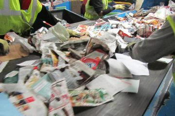Sorting through recycling  (John Mussoni/WHYY)