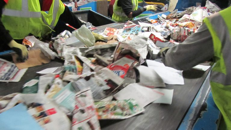 Sorting through recycling  (John Mussoni/WHYY)