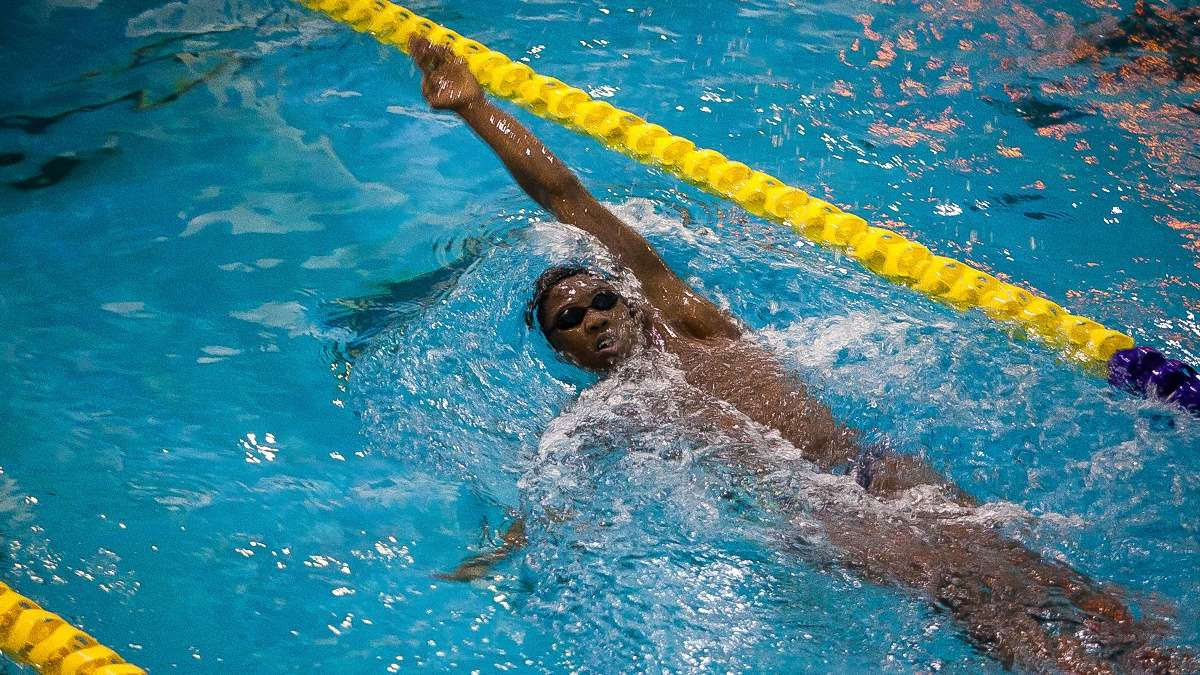 Whitley glides through the water swimming a back stroke in practice. (Brad Larrison/for NewsWorks)