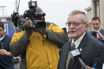 In this file photo, former Harrisburg Mayor Stephen Reed talks to reporters after his arrest on theft, bribery, corruption and other charges. (Diana Robinson/WITF)
