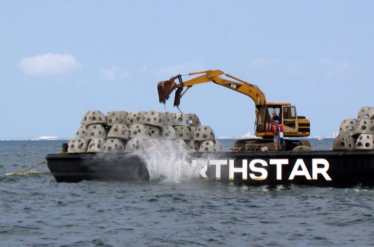 Concrete blocks dropped off a barge into the Atlantic Ocean to create an artificial reef. (Image: N.J. Department of Environmental Protection)
