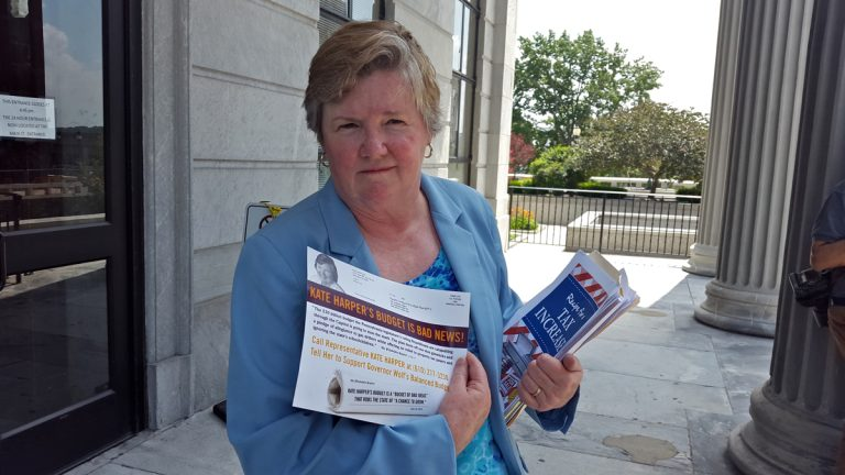 Pa. Rep. Kate Harper, R-Montgomery, holds mailings which she says unfairly depict her views on the state budget. (Laura Benshoff/WHYY)